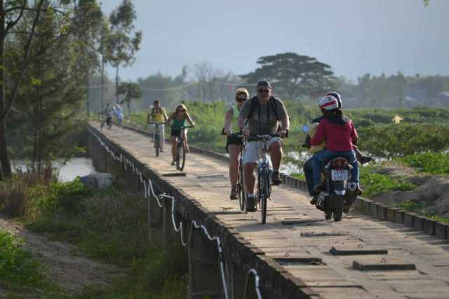 Ride bike in the country-side of Hoi An. Top 10 Things to do in Vietnam.